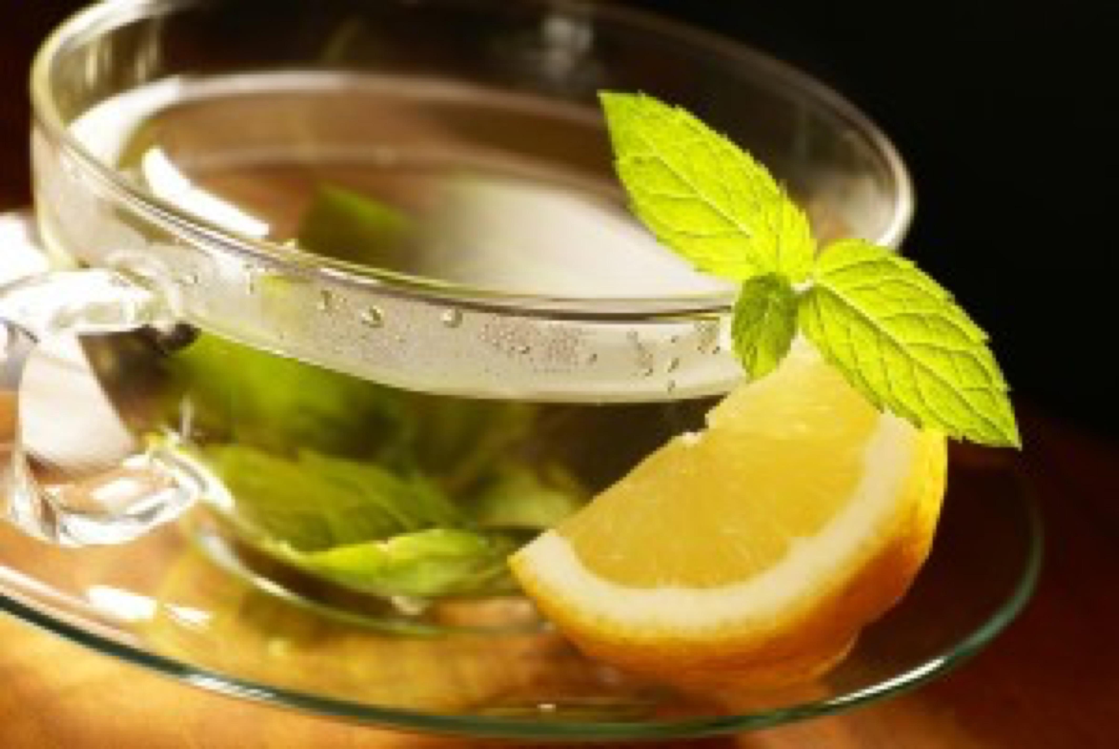 Mint tea, fresh mint leaves and lemon.