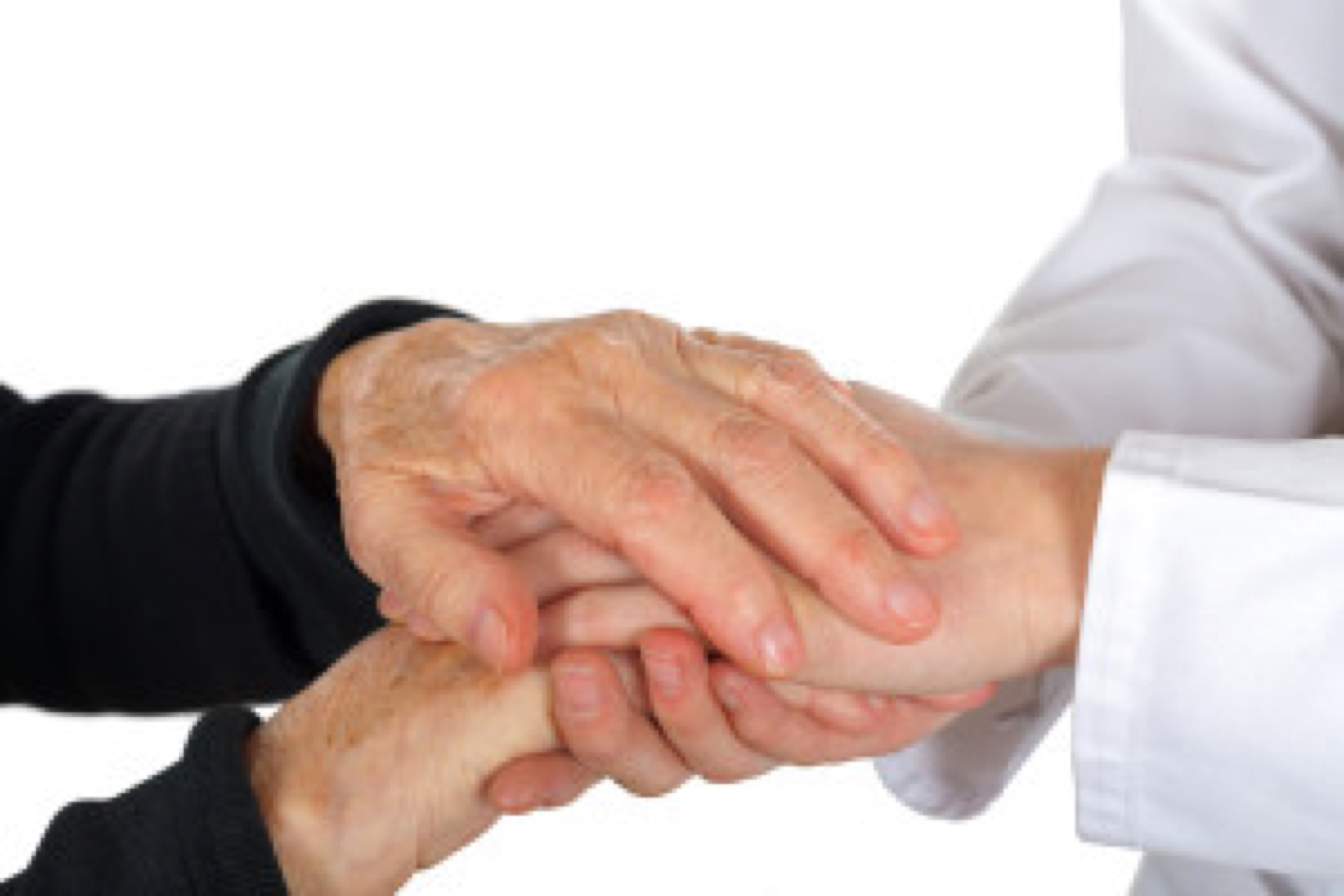 Doctor holding elderly hand on isolated background