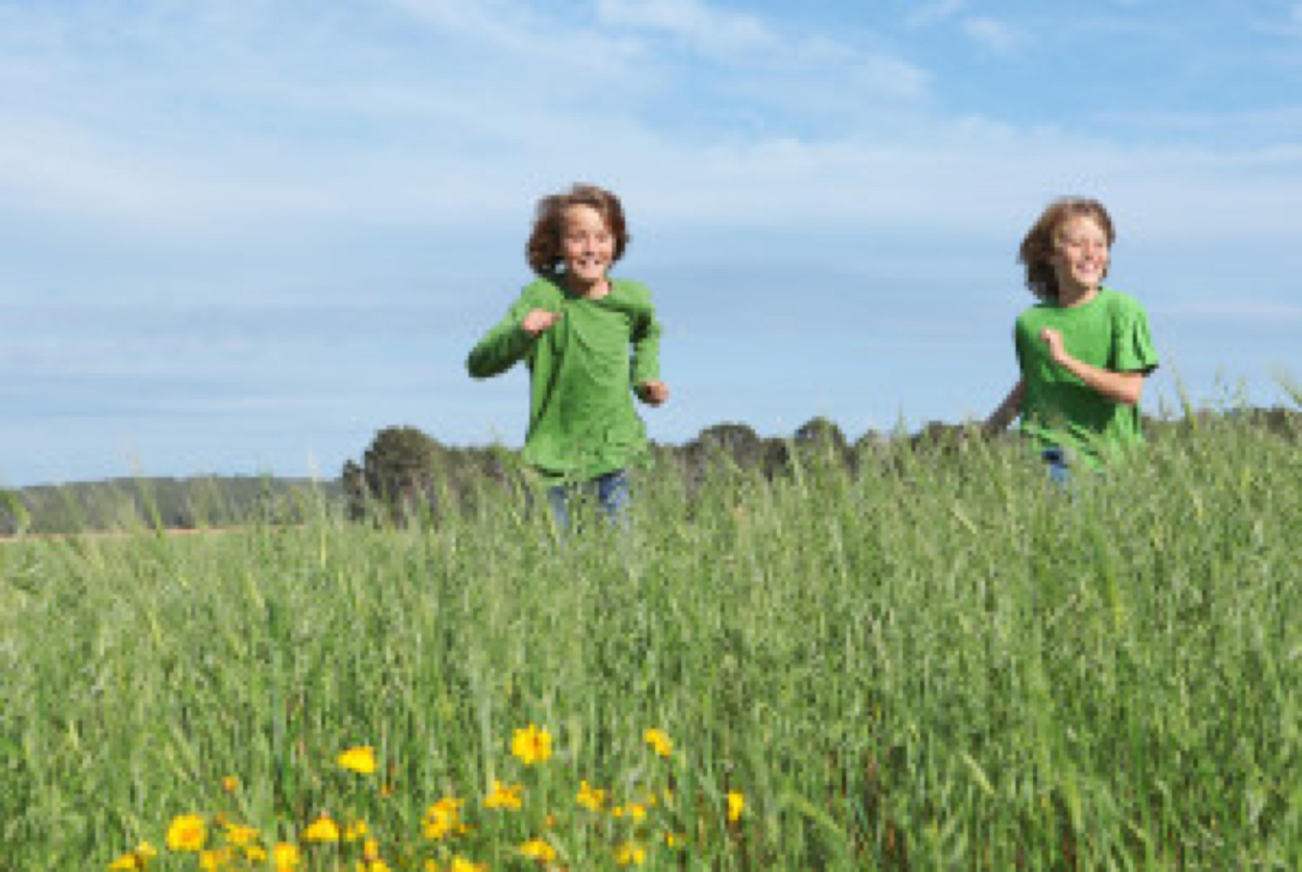 happy kids running outdoors in summer