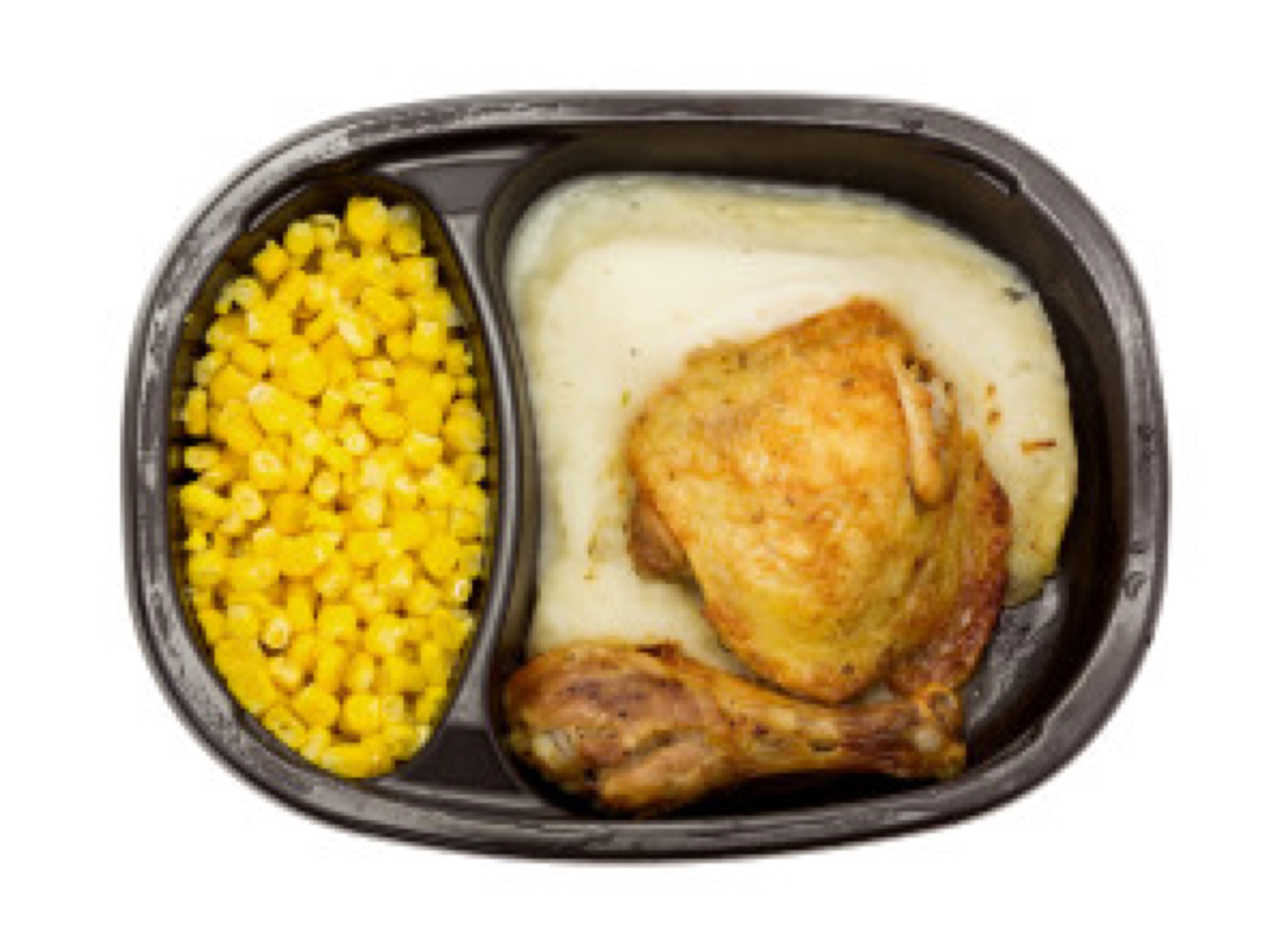 A top view of a frozen TV dinner on a white background.