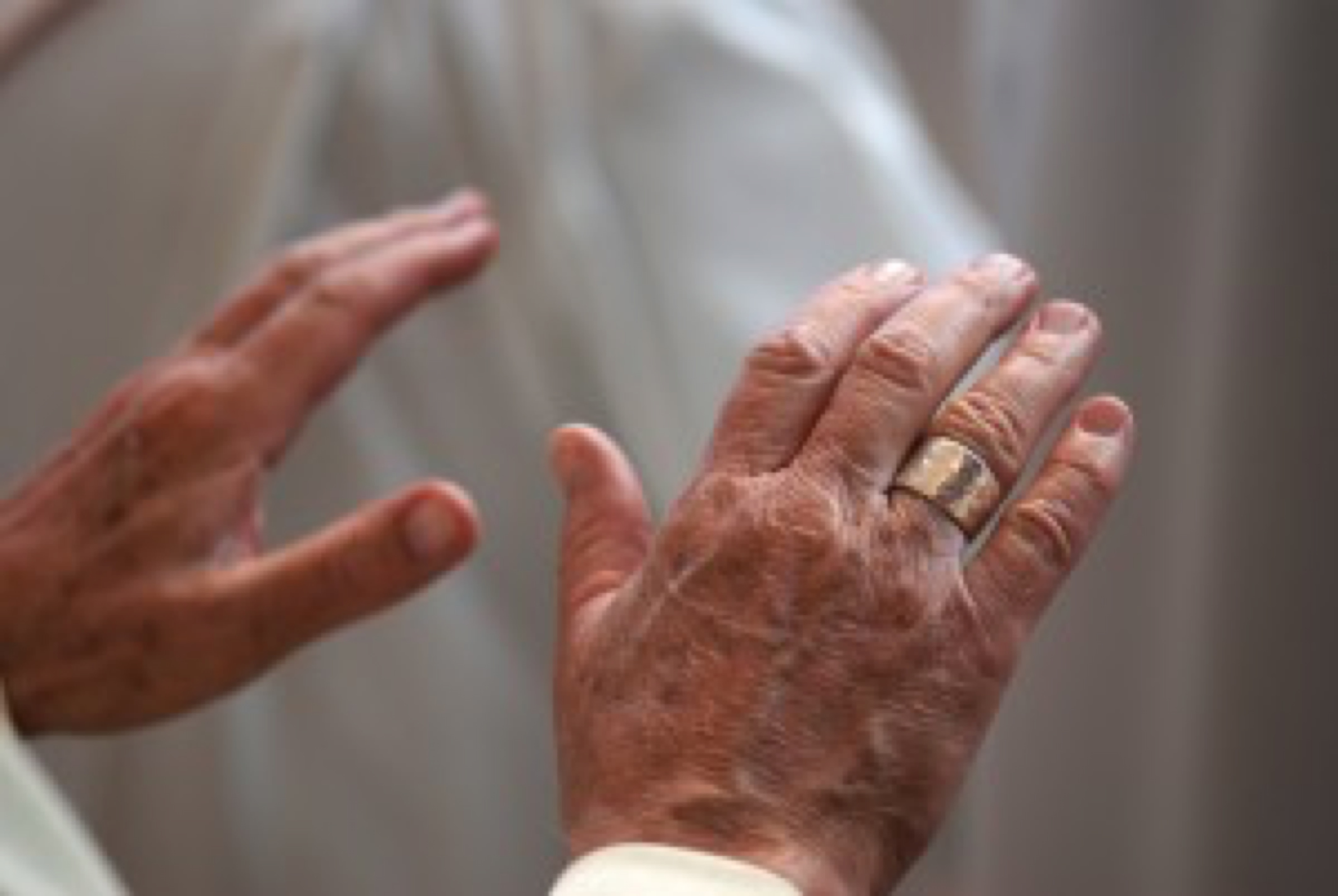 Hands of a Catholic priest, praying. Hands in this position for blessing.
