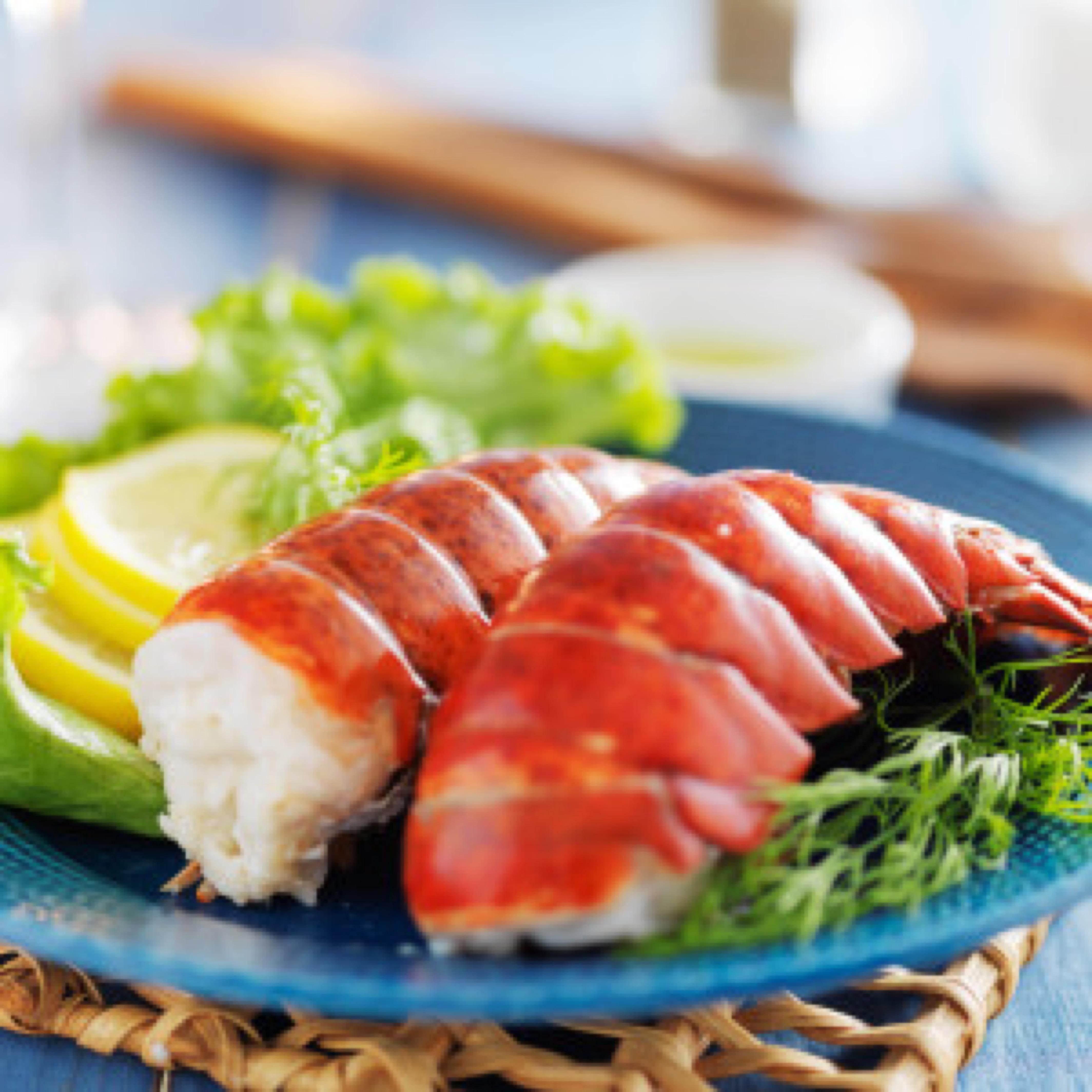 lobster dinner with lemon and lettuce garnish