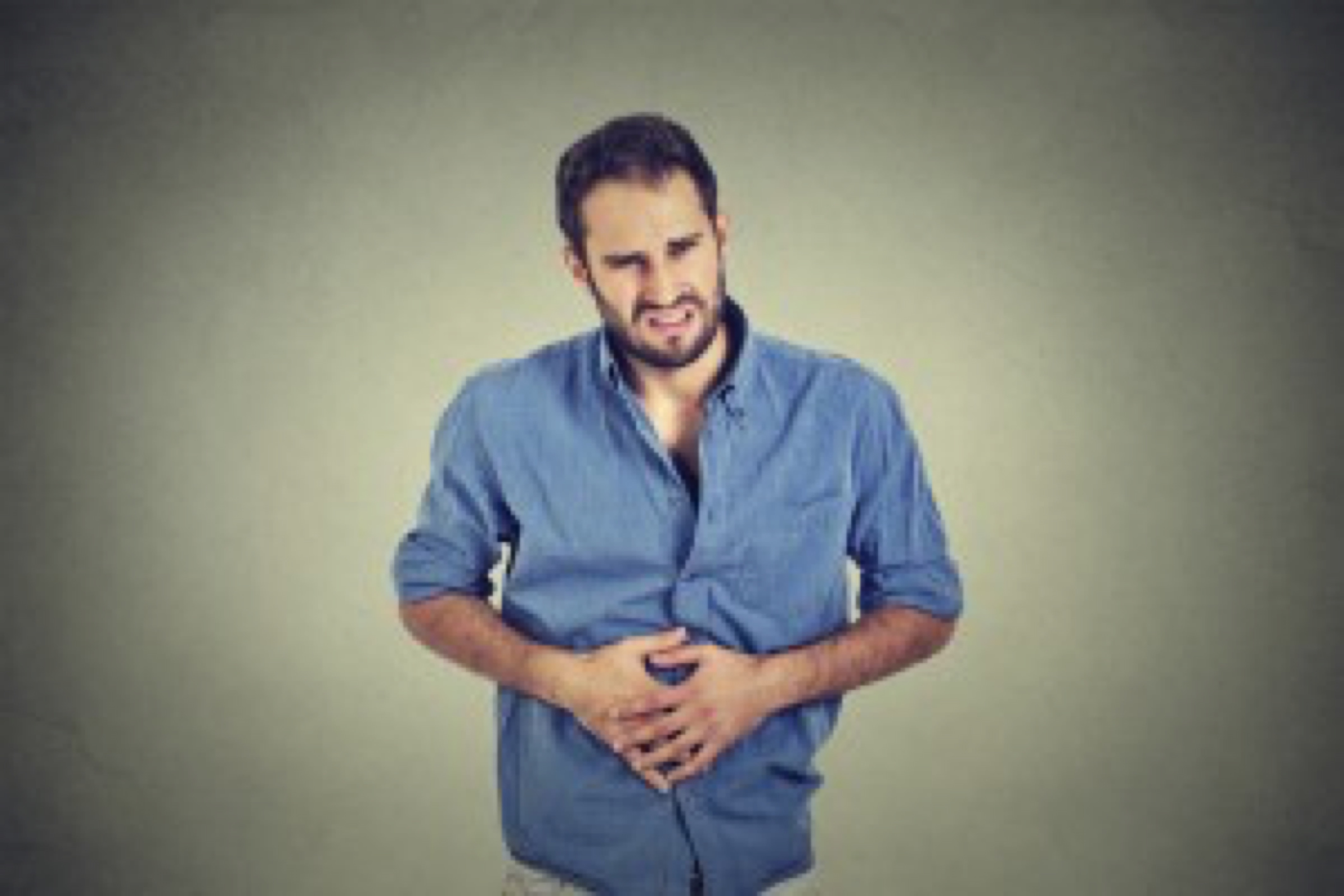 Young man with stomach pain indigestion