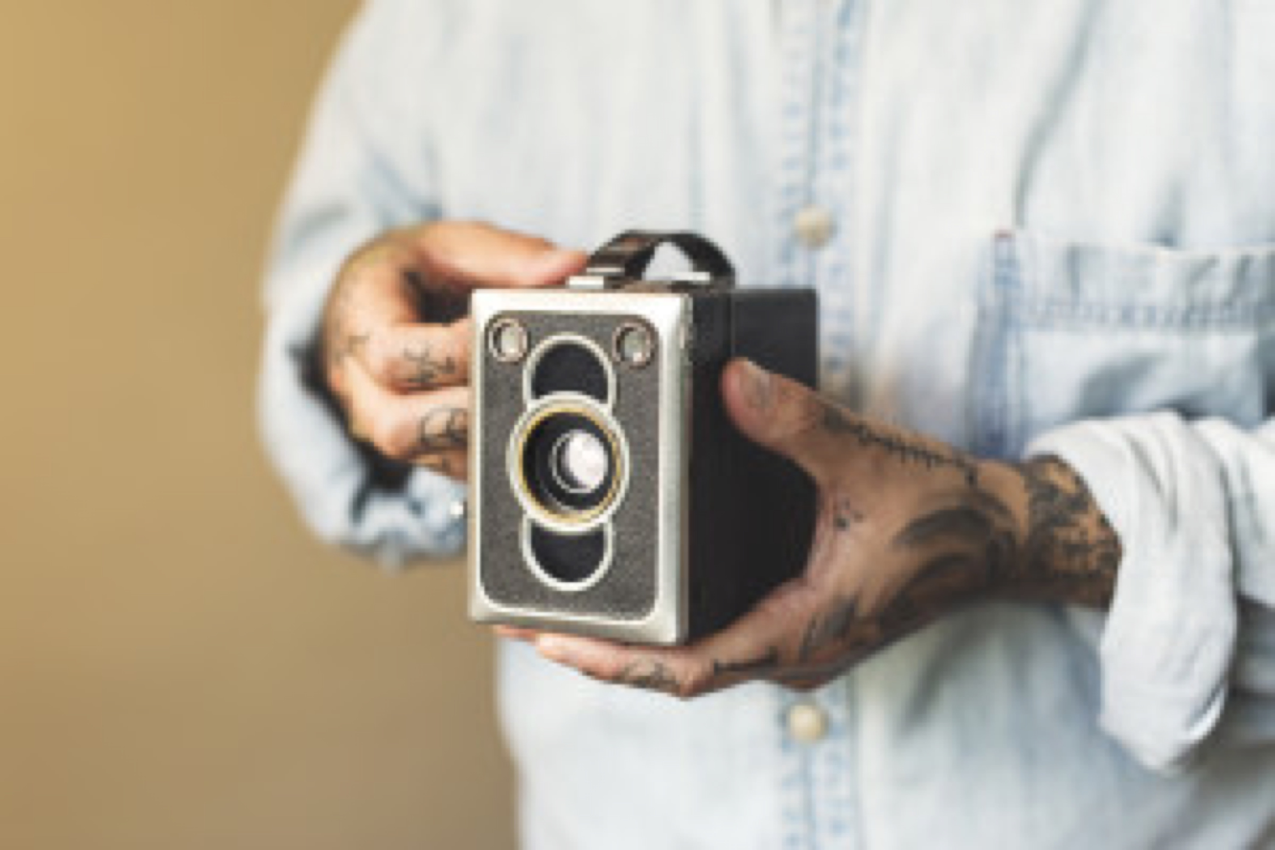 Man holds camera and taking photo