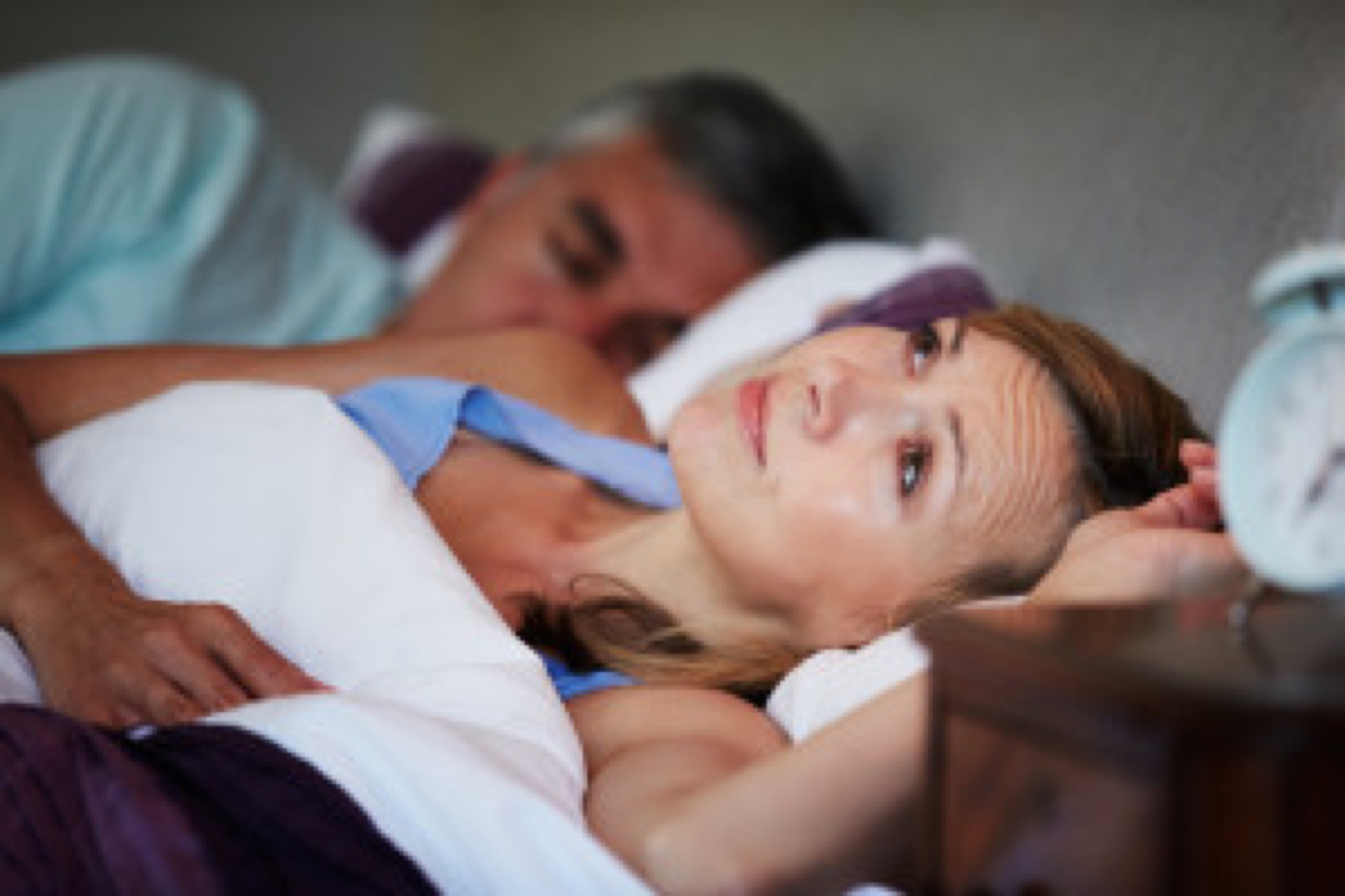 Couple In Bed With Wife Suffering From Insomnia Late At Night