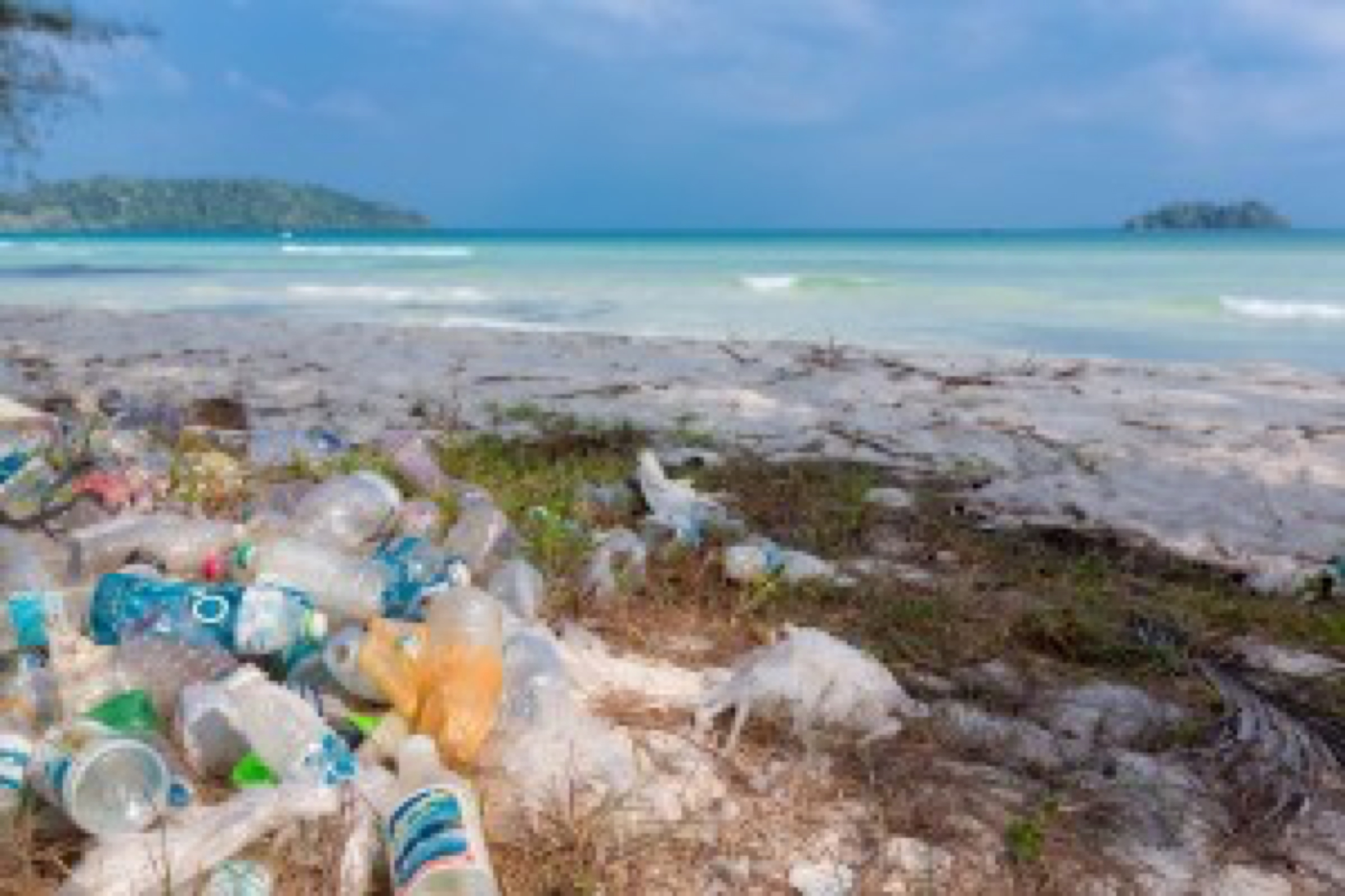 Koh Rong, Cambodia - January 24, 2016: Garbage and plastic bottles on a beach left by tourist at, Rong Island near Sihanoukvile. Anvironmental pollution concept picture, Cambodia. South East Asia 2016