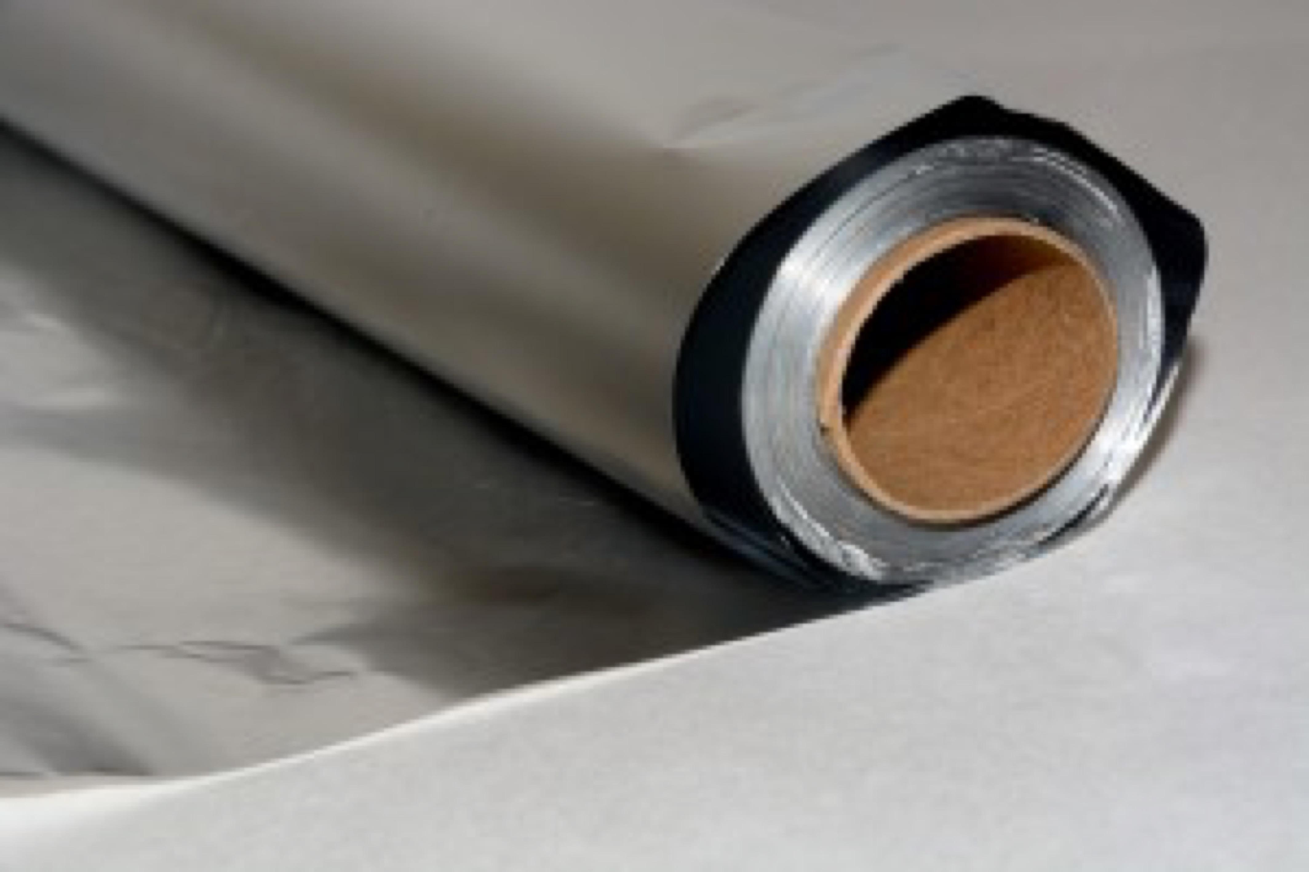 Roll of aluminum foil on white background